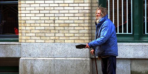 Swedish shopkeeper charged for drenching beggar