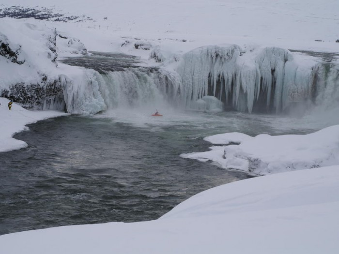 Singer Songwriter Descends Down Icy Waterfall