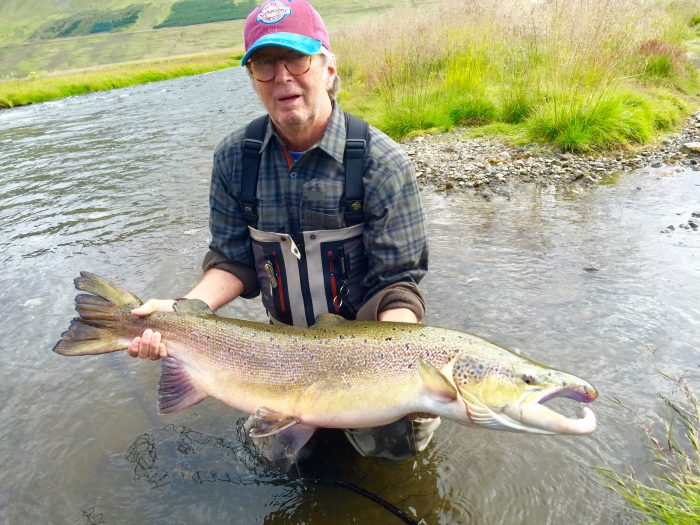 Eric Clapton lands the biggest salmon of the summer